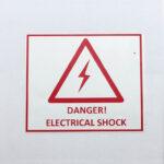 """Этикетки 50*60 мм красным рисунком """"Опасность поражения электрическим током"""""""